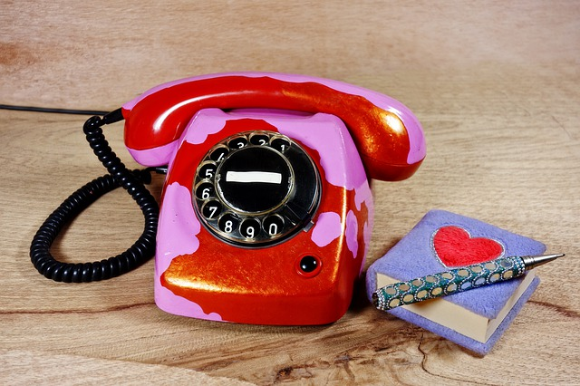 Red telephone and book with heart on it